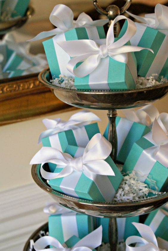 bridal shower favors packed into tiffany blue boxes and with white ribbons will be a nice idea for such a themed party