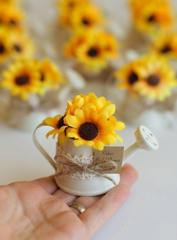 cute little water cans with sake sunflowers to give as whimsy wedding favors