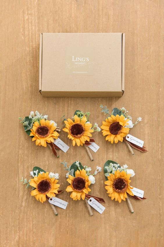 cute wedding boutonnieres of sunflowers with greenery and white blooms are bright touches