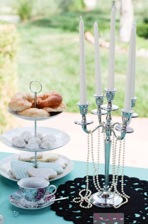 decorate your dessert table with a large candelabra with pearls, black lace and white candles