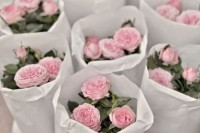potted pink peonies in paper bags are cool spring or summer wedding favors