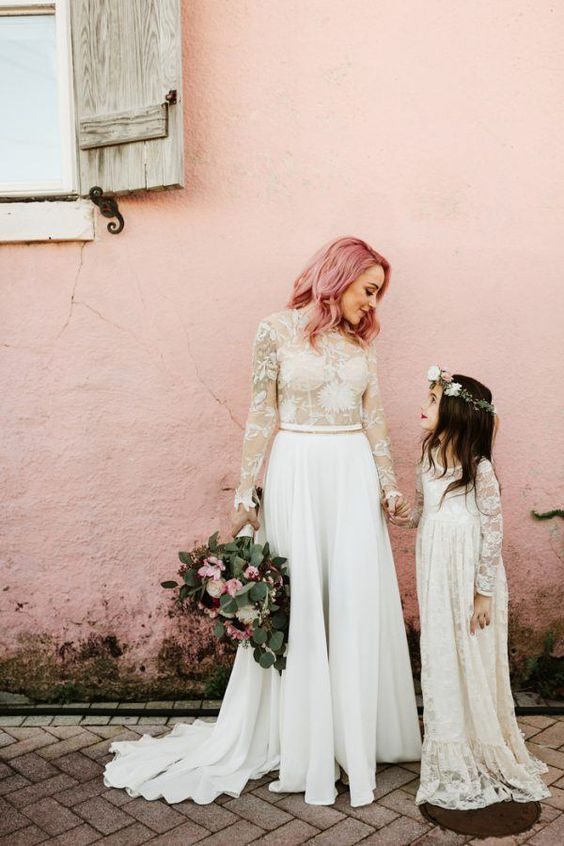 lovely pink wavy and textural middle length hair and a lace top and a pleated skirt for a romantic look