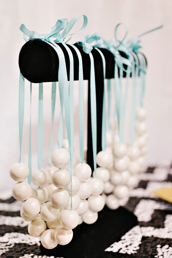 offer your gals necklaces of pearls or white beas and turquoise ribbons