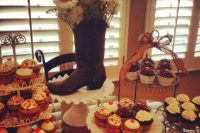 style your dessert table with lace and wire stands and a cowgirl boot with blooms and greenery