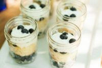 simple desserts with fresh berries in jars are nice for a cowgirl bridal shower