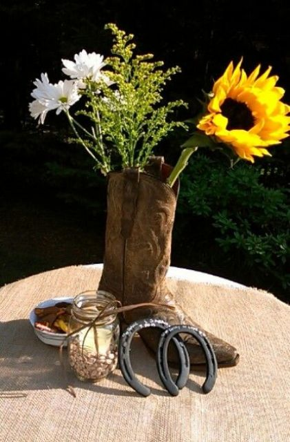 a cowgirl boot with wildflowers and a sunflower is a nice and simple themed bridal  shower centerpiece