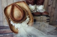 dress up in cowgirl boots with lace and a straw hat with fabric blooms and a veil so that eveyrone identified you as a bride