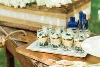 desserts displayed on a table with lace, wheat and a box with white hydrangeas for a rustic look