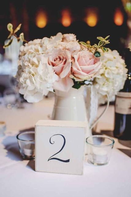 Gentle table centerpiece with ceramic jug and roses