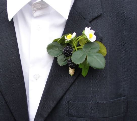 Groom boutonniere with blackberries