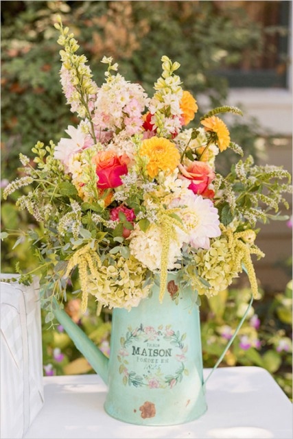 wedding flowers in a vintage water can