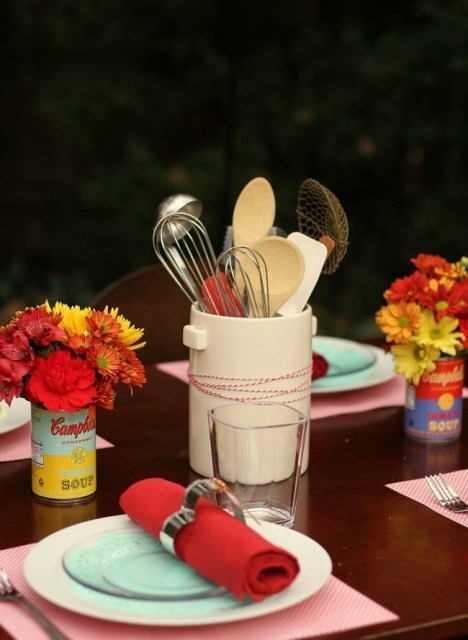 Table centerpieces with kitchen supplies