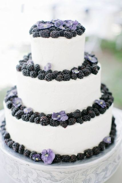 Three tiered wedding cake with blackberries