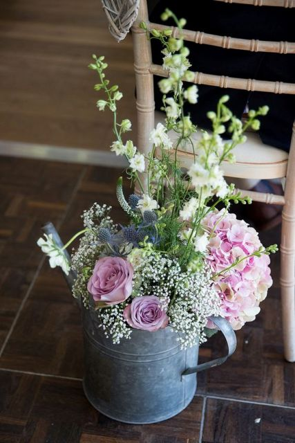 Rustic Spring Centerpiece : Watering cans on your wedding decor cute ideas to