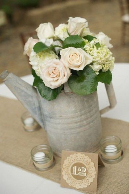 Watering can table number with roses