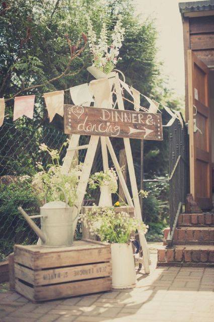 nice outdoor wedding decor with crates and water cans