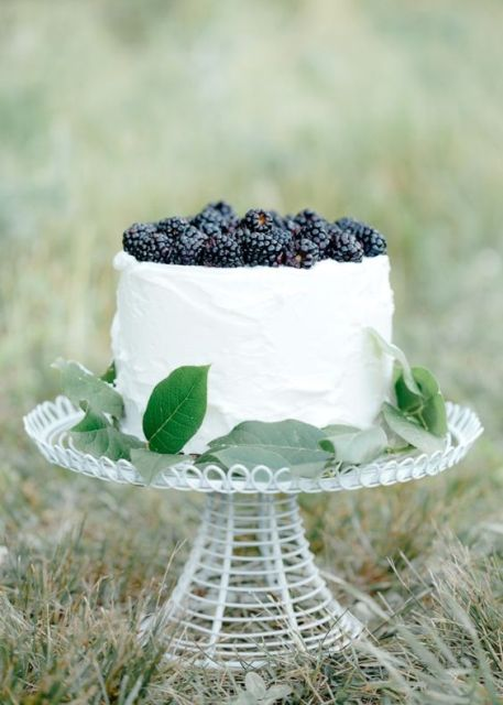 Wedding cake with blackbarries and greenery