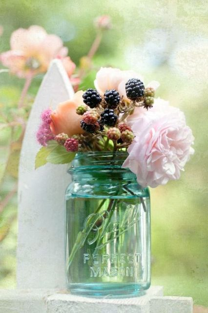 Wedding centerpiece with blackberries and flowers