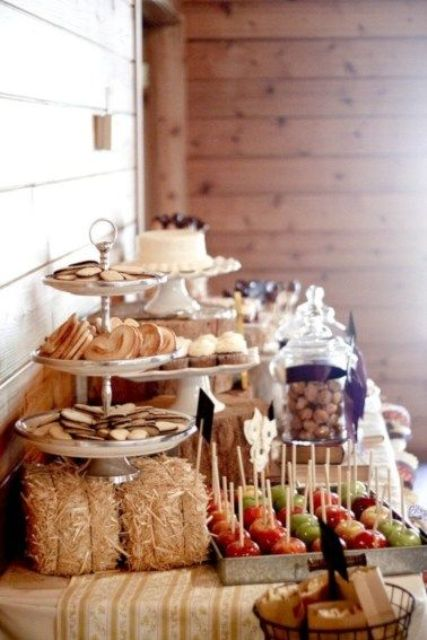 a rustic bridal shower dessert table with hay, apples, cookies and lots of delicious stuff