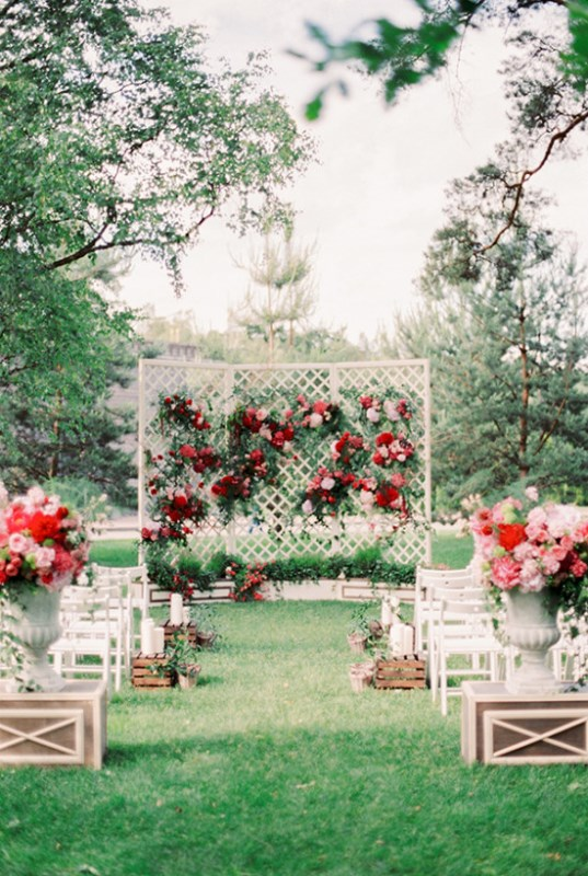 Picture Of vintage chic red pink garden wedding  10