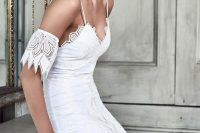 01 Samba. Spaghetti straps wedding dress with delicate lace and arm decorations