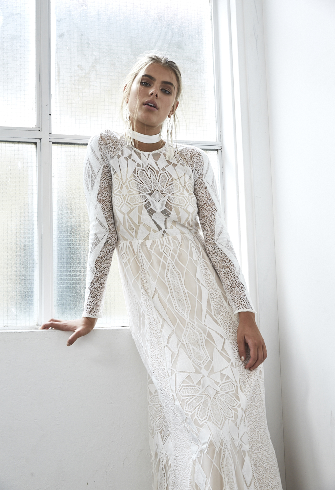 Soho. The bodice features a blush hued plunging, angular lining, which is perfectly complimented by the combination of unique ivory laces, which create an enchanting effect on the skin
