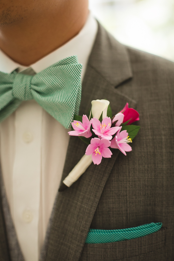the groom rocked a bold boutonniere and mint details