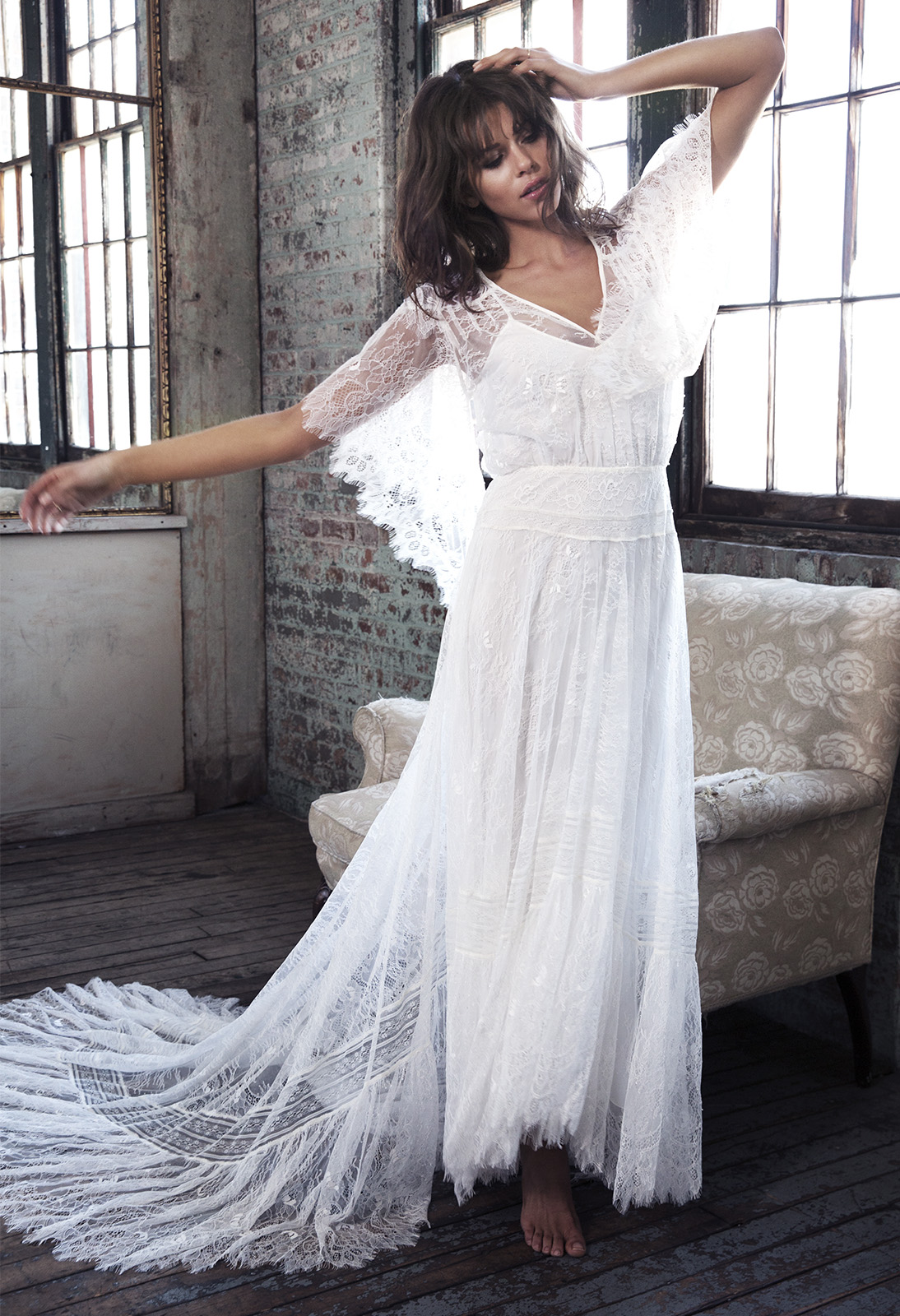 Sofia. Beginning with a flattering, V neckline, the Sofia features embroidered French lace shoulders and cap sleeve panels which flow into a graduated, waterfall sleeve