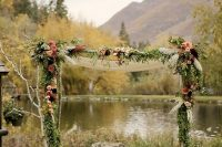 09 moody wooden arch with dark florals and greenery