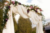 11 moody floral arch with white farbic