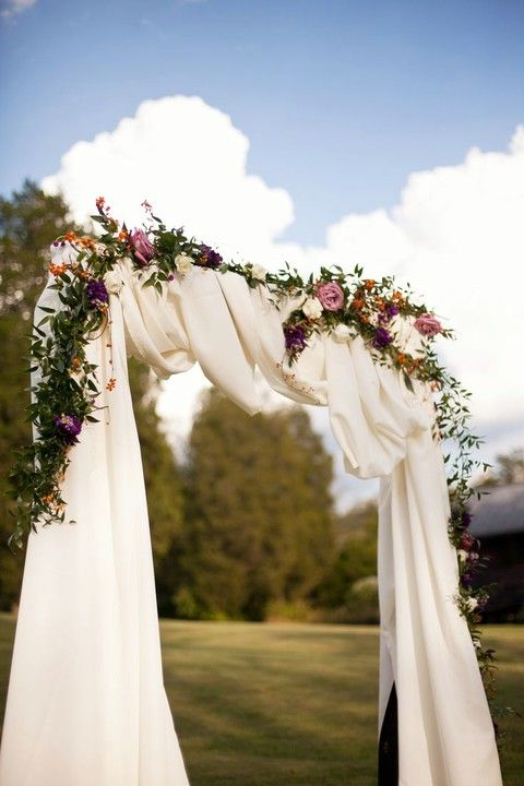 moody floral arch with white farbic