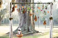 12 boho fall arch with hanging flowers and leaves
