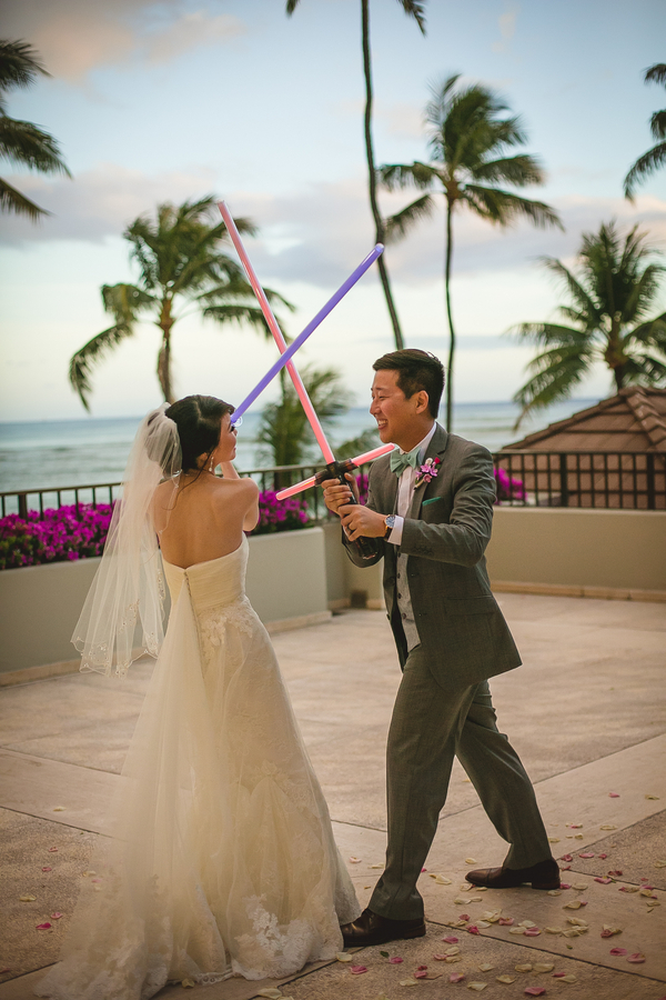 the bride and the groom fighting with lightsabers