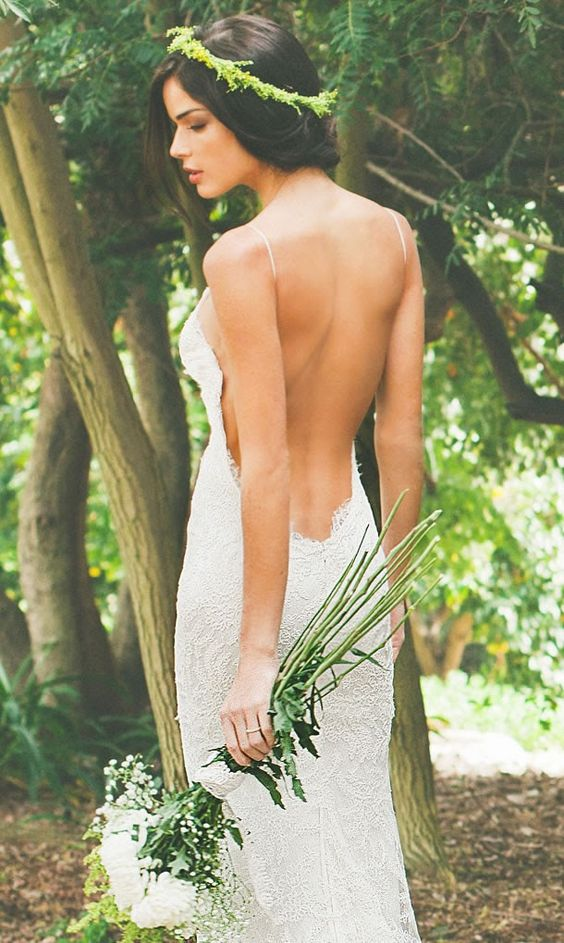 Open back dresses with spaghetti straps are perfect for any summer wedding if you foresee hot weather.