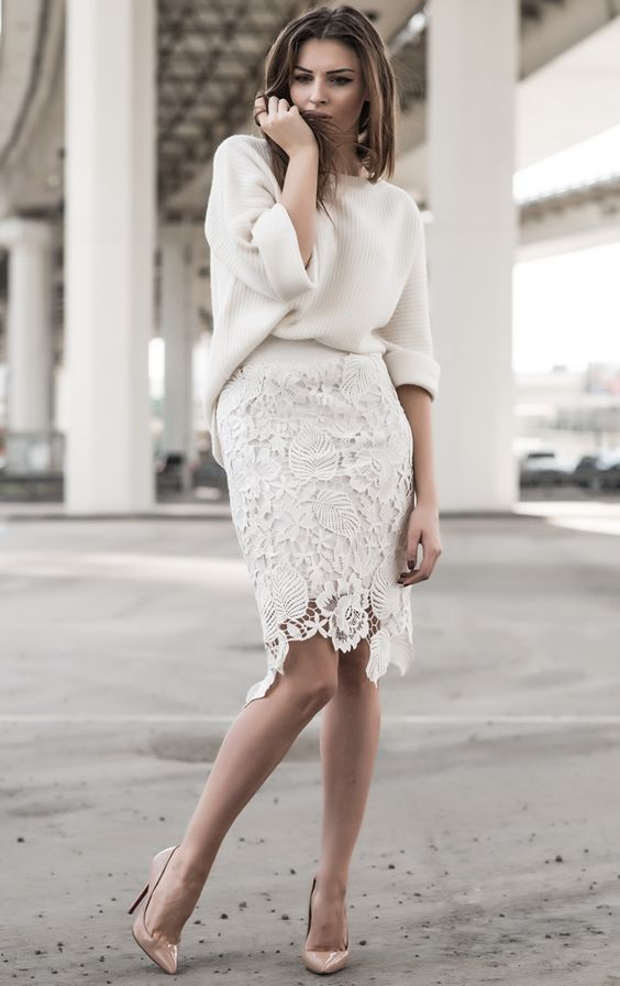 white lace over the knee skirt, an off white sweater and nude pumps