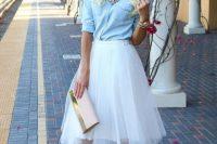16 white tutu, a denim shirt, a statement necklace and blush shoes