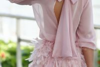 17 pink back bow dress with a feather skirt