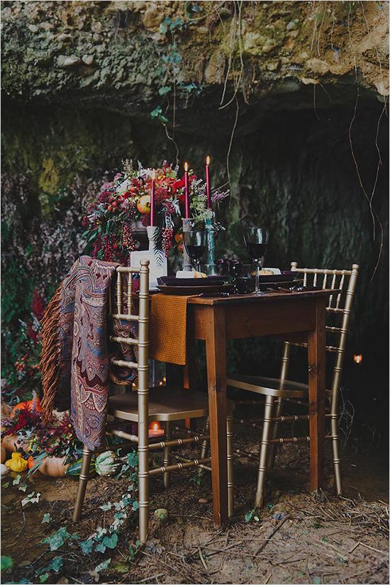 boho chic fall wedding table setting in a cave