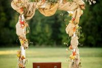 19 fabric covered arch with bold leaves