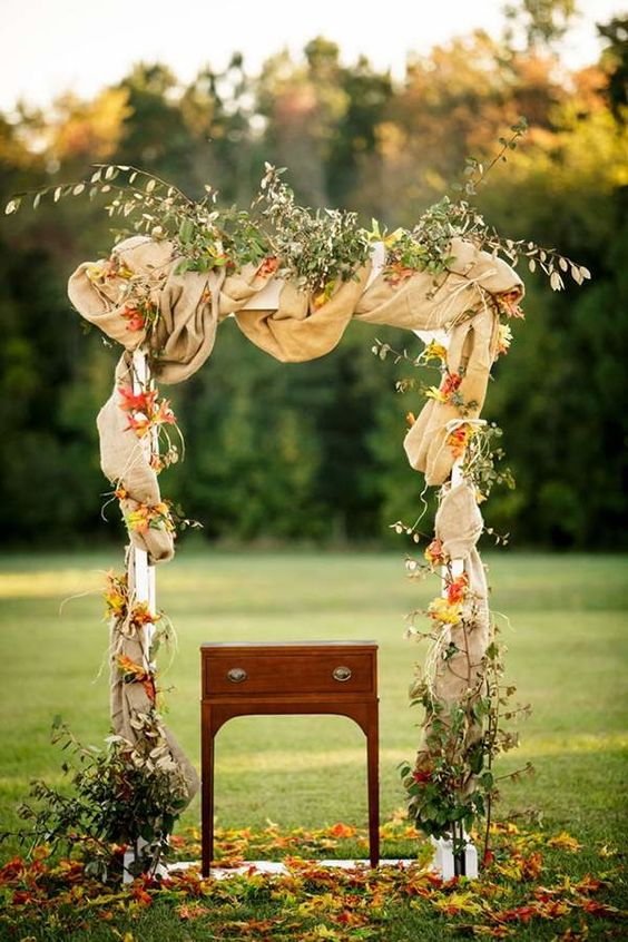 fabric covered arch with bold leaves