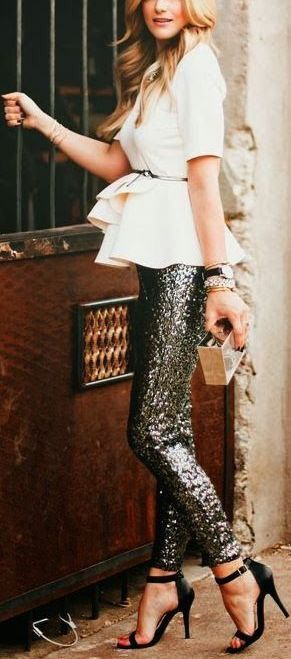 black sequin pants and a white peplum top