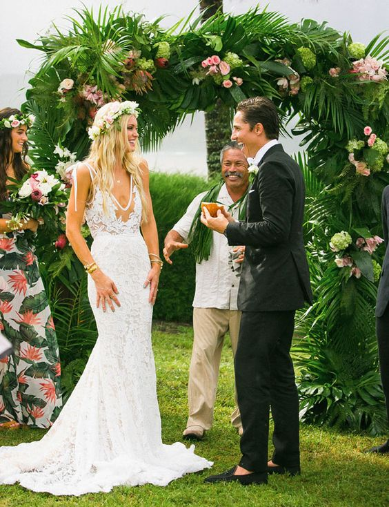 This wedding dress with a plunging neckline is amazing not to feel hot and boho chic flavor looks great in the tropics.
