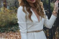 21 white jumpsuit with long sleeves and a think belt
