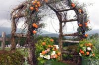 23 rustic wooden arbor with orange flowers