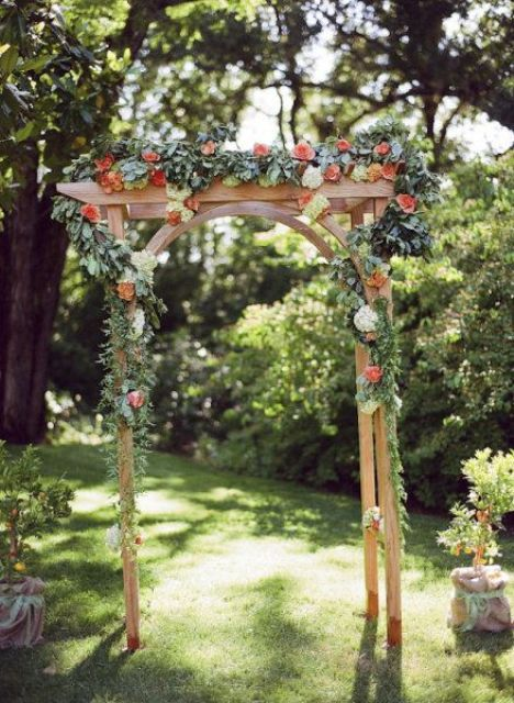 fall garden arch decorated with florals