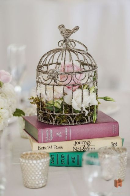 Birdcage table centerpiece with books