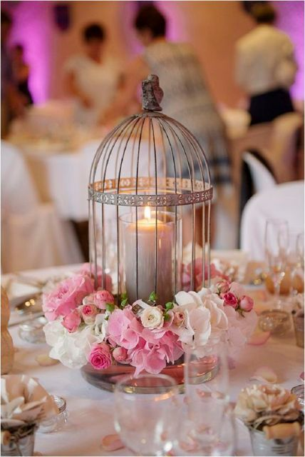 Birdcage table centerpiece with candle and flowers