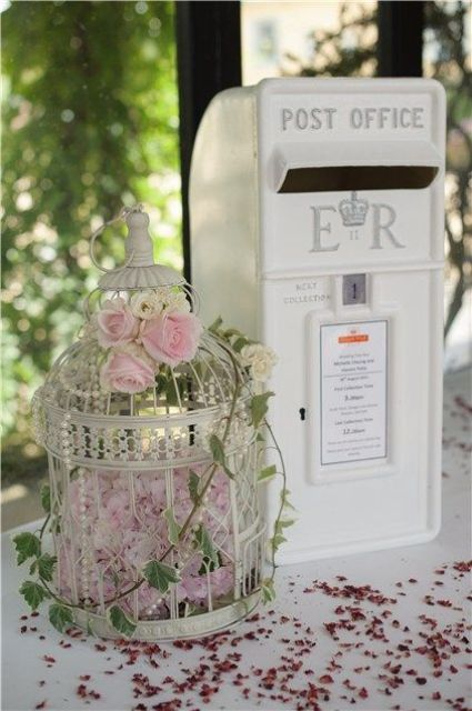 Birdcage wedding decor with roses
