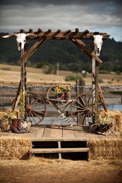 Ceremony decor idea with wagon wheel