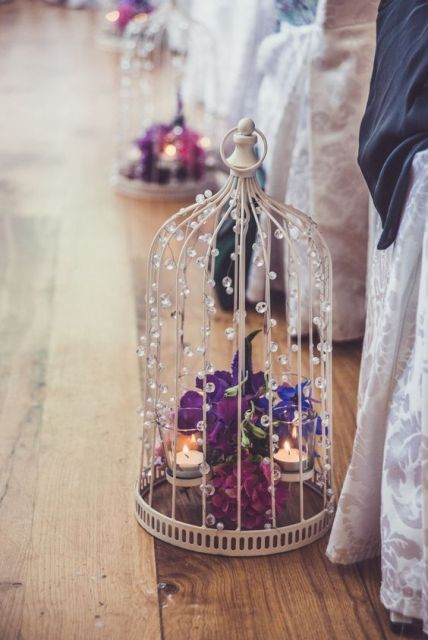 Chic aisle decor with flowers and candles
